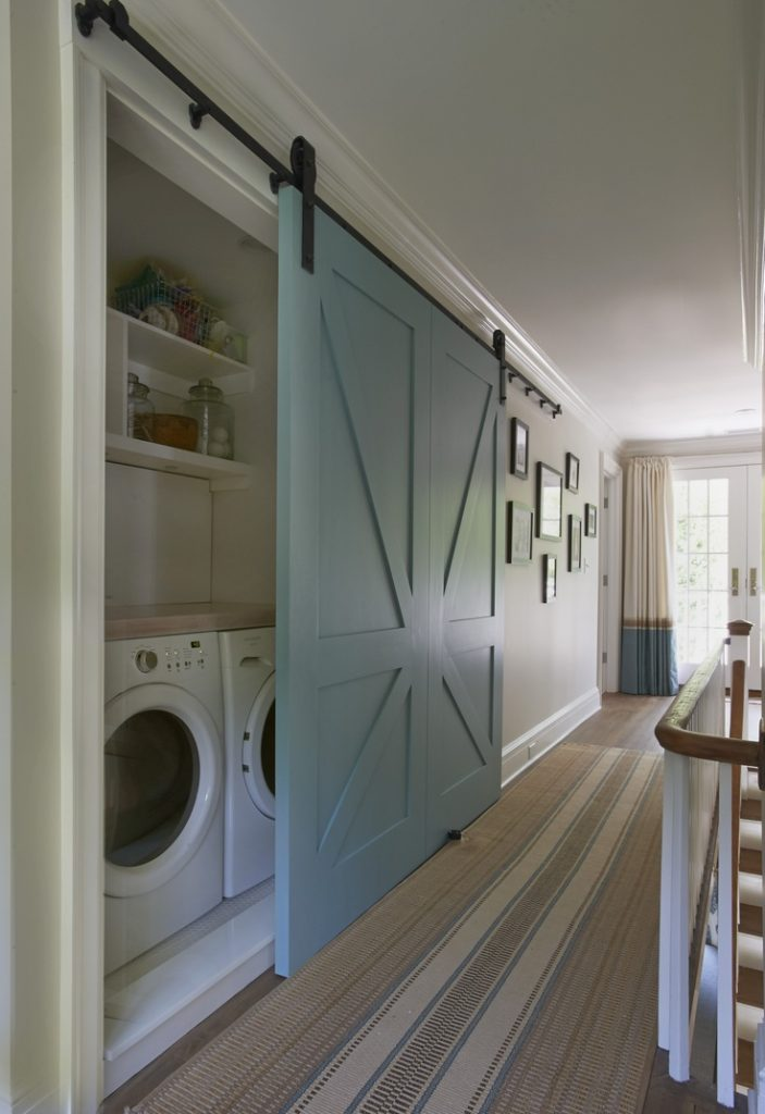 Beautiful way to keep a laundry room hidden but accessible.